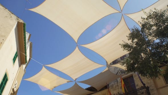Thumbnail for Parasols Hanging Over the Street of a Small Southern European Town