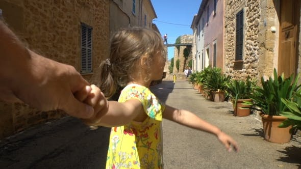 Thumbnail for Little Cute Girl Leading Parent To the Adventure in an Old European Town