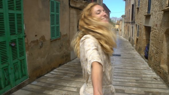 Thumbnail for Young Woman Leading a Man To the Adventure in an Old European Town.