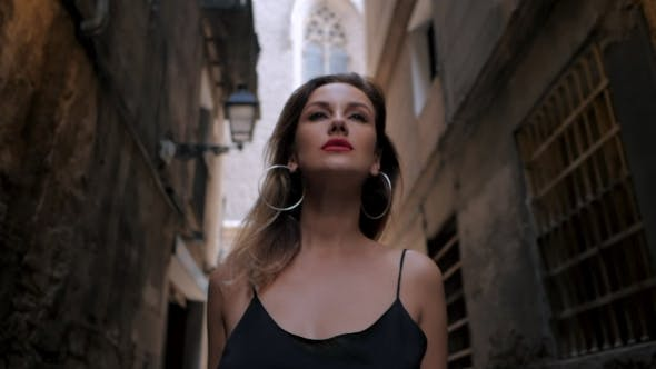 Thumbnail for Front View of Sexy Elegant Woman Walking in the Old European City. Attractive Lady in Long Black