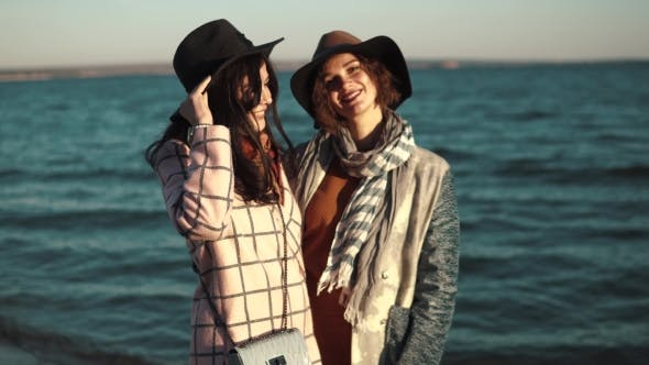 Thumbnail for Portrait of Two Friends on the Background of Autumn Sea. Beautiful Girl Smiling and Happy