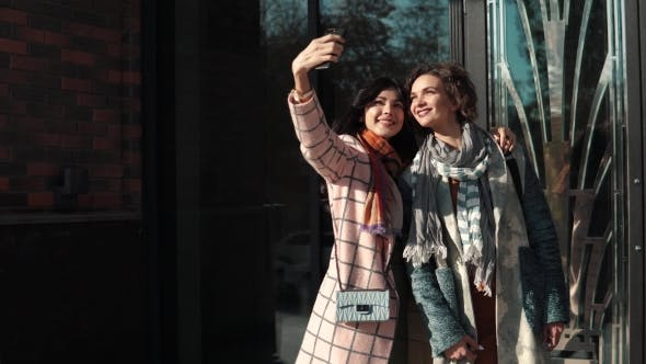 Thumbnail for Girlfriends Make Selfie on a Mobile Phone in the City.