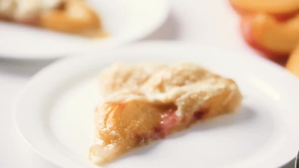 Thumbnail for Slice of home made peach galette with lcoal peaches.