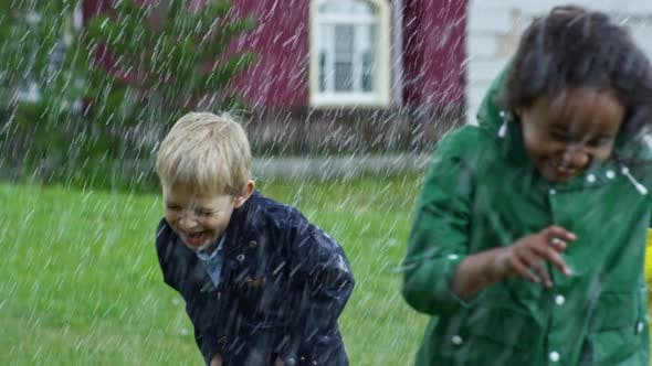 Thumbnail for Happy Children Running in Heavy Rain