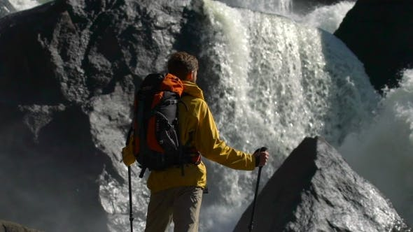 Thumbnail for Backpacker Watches a Waterfall in .
