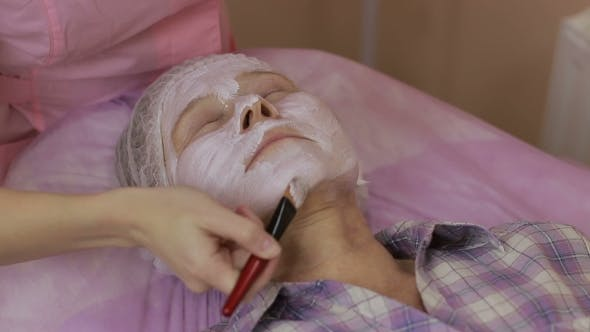 Thumbnail for Woman Receiving Facial Mask in Spa Beauty Salon