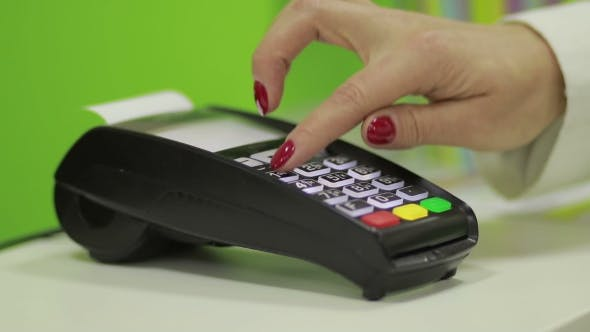 Cover Image for Hand Using Bank Terminal for Credit Card Payment