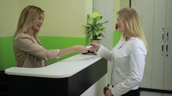 Thumbnail for Happy Woman Paying with Credit Card at Spa Salon
