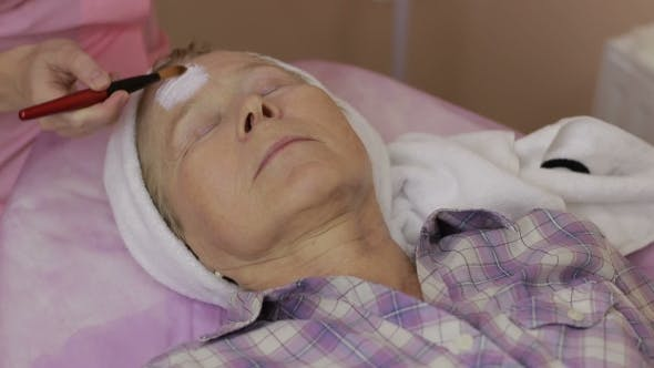 Cover Image for Elderly Woman Getting Facial Mask at Spa Salon