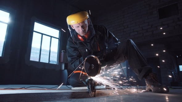 Cover Image for Man Cutting Metal Using Grinding Machine