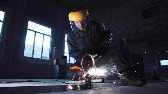 Thumbnail for Workman Angle Grinding in Protective Clothing