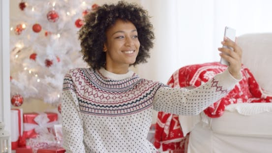 Cover Image for Happy Young Woman Posing for a Christmas Selfie
