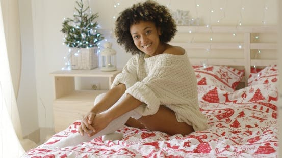 Thumbnail for Sexy Young Woman Relaxing on Her Bed at Christmas
