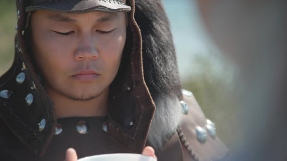 Thumbnail for Oriental Warrior in Leather Armor, Holding Cup of Hot Drink.