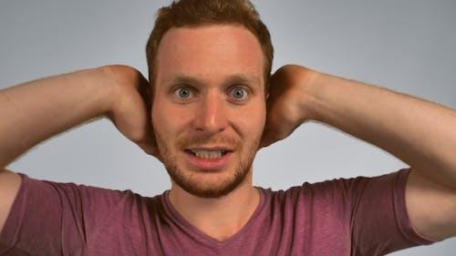 Redhead Male Shows Feeling Awful Music