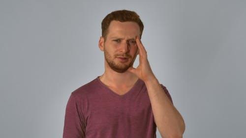 Portrait Ginger Has Migraines