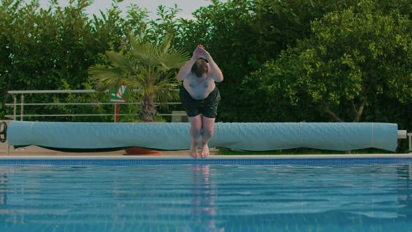 Thumbnail for Man Jumping Into Swimming Pool