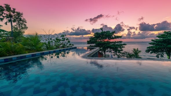 Cover Image for Beautiful Tropic  Sunset Over Infinity Pool in Bali