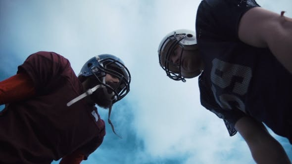 Thumbnail for Two American Football Players Discussing Tactics