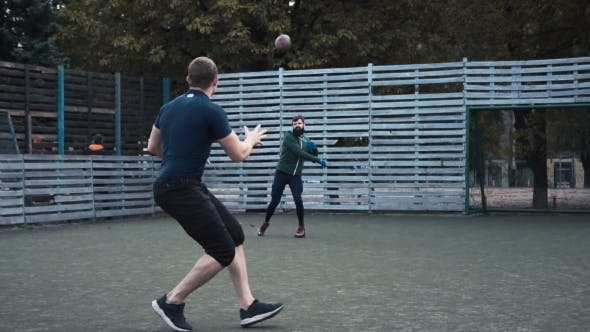 Thumbnail for Two Men Practising American Football on Field