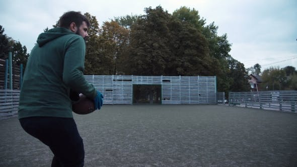 Thumbnail for Two Men Practising Ball Passing on Field