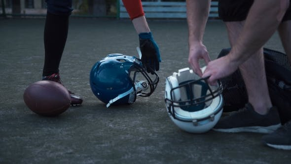 Thumbnail for American Football Players Preparing Helmets