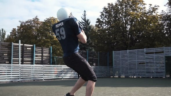 Thumbnail for Two Men Training American Football on Field