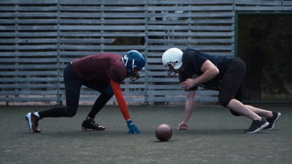 Thumbnail for Two Helmeted Football Players