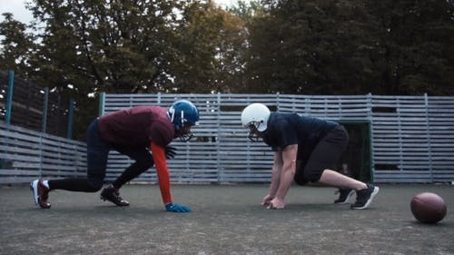 Two Helmeted Football Players