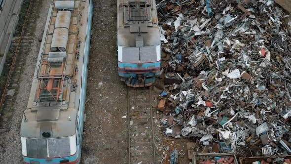 Thumbnail for A View From Above of Old and Broken Trams, Next To Them Is a Non-ferrous Metal