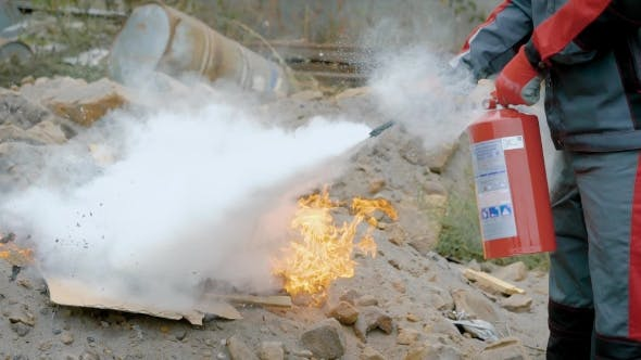 Thumbnail for A Man Holds a Fire Extinguisher in His Hands and Extinguishes the Fire Box with a Foam