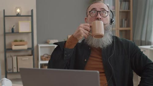 Man Finishing Stressful Business Video Call