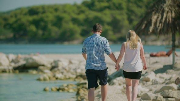 Thumbnail for Couple Walking on Sea Shore