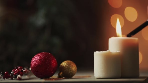 Thumbnail for Christmas the Hand of a Young Woman Lights Candles Near the Christmas Tree on the Background of