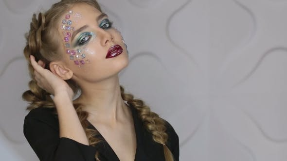 Thumbnail for Fashion Makeup Woman with Colorful Makeup and Body Art