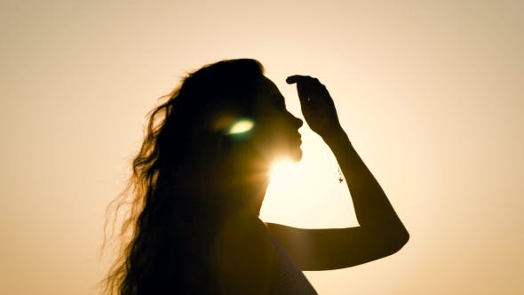 Thumbnail for Woman Posing in Back Light on Sky Background.