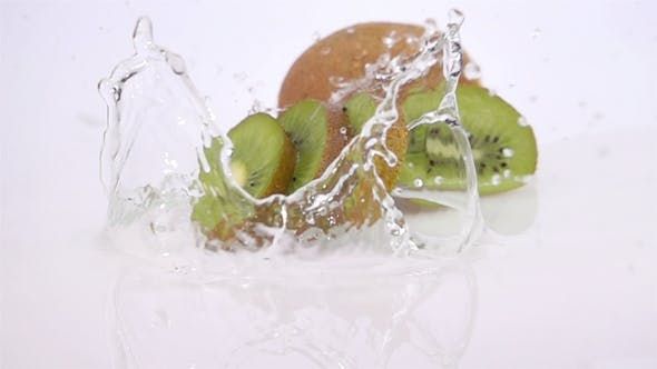 Thumbnail for A Several Slices of Kiwi are Falling on the Table.