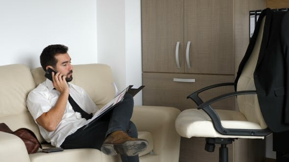 Thumbnail for Tired Businessman on the Couch Talking on the Phone