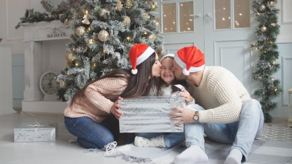 Thumbnail for Christmas Magic Gift Box and a Woman Happy Family Mother and Child