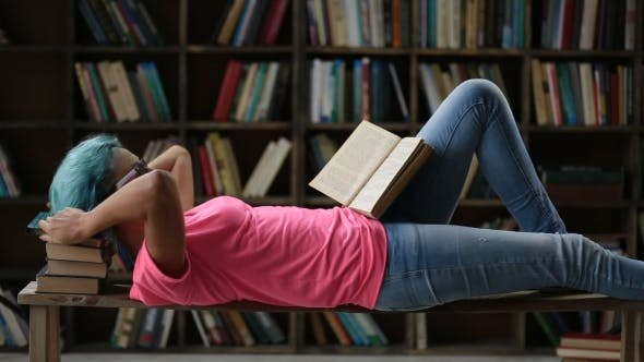 Thumbnail for College Female Student Studying Hard in Library