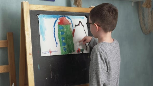 Thumbnail for Child Shows His Drawing