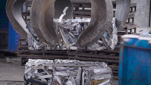 Grapple for Scrap of Stationary Reloader Is Setting Compressed Scrap Metal in the Briquettes