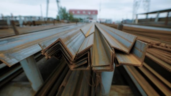 Thumbnail for Vintage Rusted Steel Section Are Stacked in a Rubbish Dump Outside in Evening