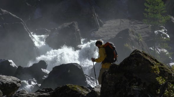Thumbnail for A Male Hiker Goes To a Waterfall in .