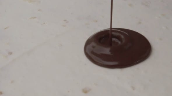 Thumbnail for Chocolate Is Poured Onto a Cake