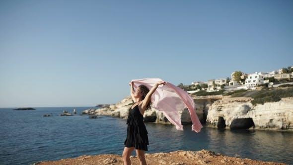 Thumbnail for Happy Girl with Scarf Enjoy the View at the Ocean