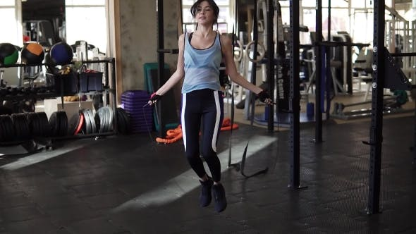 Thumbnail for Skipping Woman Training at the Gym Working Out. Fit Young Woman Skipping Rope