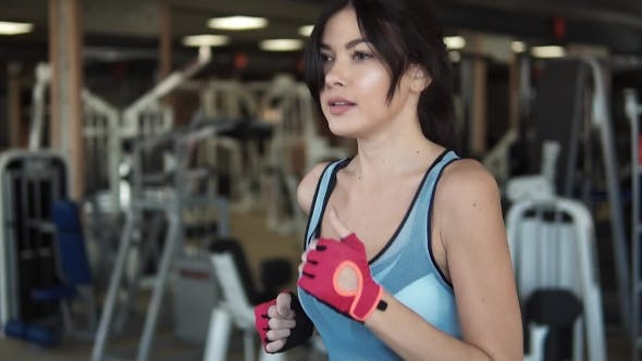 Thumbnail for Attractive Young Girl Running on a Treadmill. Cardio Exercises in the Gym