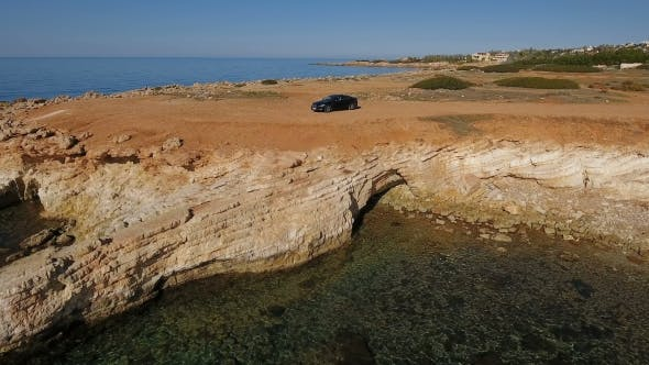 Thumbnail for Black Car Stands Near the Sea in Cyprus
