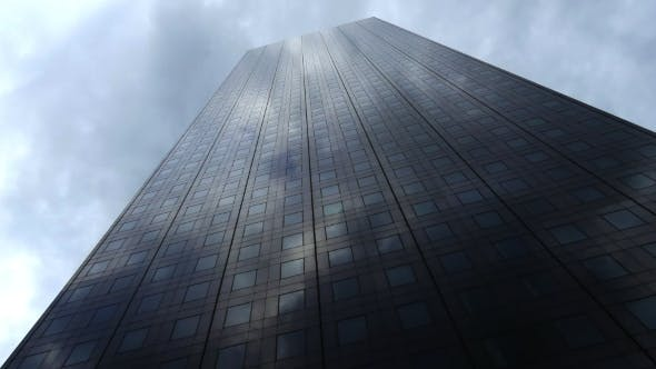 Thumbnail for Cloudy Sky Reflecting on Modern Skyscraper Facade